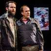 This theater image released by Portland Center Stage via Columbia University  shows Danny Wolohan as Dan O'Brien, left, and William Salyers as Paul Watson during a performance of