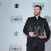 Justin Timberlake, winner of the Favorite Album, Favorite Male Artist and Favorite R&B Artist awards poses in the press room at the 40th annual People's Choice Awards at Nokia Theatre L.A. Live on Wednesday, Jan. 8, 2014, in Los Angeles. (Photo by John Shearer/Invision/AP)