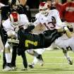 Midwest City runningback Ronnie Davis is upended by a trio of Owasso tacklers on this first half carry during Class 6A playoff game between Midwest City Bombers and the Owasso Rams at Jim Darnell Stadium in Midwest City, Friday night, Nov. 18, 2011.  Photo by Jim Beckel, The Oklahoman