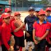 Boys listen to their coach during a baseball practice in the hometown of Detroit Tiger's Miguel Cabrera, in Maracay, Venezuela, Friday, March 28, 2014. Cabrera, 30, learned to play on this same field, now remodeled thanks to his economic support. On Friday, he signed the richest contract in baseball history, a $292 million 10-year deal with the Tigers. (AP Photo/Alejandro Cegarra)