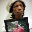 JoNita Normore poses with a picture of her son Ra'Mon as she talks about his murder at a coffee shop in Oklahoma City on Tuesday, Dec. 28, 2010. Ra'Mon was killed in 2009. Photo by John Clanton, The Oklahoman
