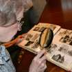 Vivian Hardcastle looks at an old family photo album Tuesday, April 3, 2012.  Zeke Campfield - The Oklahoman
