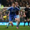 Chelsea's Nemanja Matic, left shields the ball from West Ham's Kevin Nolan during their English Premier League soccer match between Chelsea and West Ham United at Stamford Bridge stadium in London, Wednesday, Jan. 29, 2014.(AP Photo/Alastair Grant)