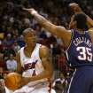 Miami Heat forward Caron Butler, left, looks for an opening past New Jersey Nets center Jason Collins during the first quarter Wednesday, April 14, 2004 in Miami. Butler scored 22 points as the Heat beat the Nets 96-84. (AP Photo/Wilfredo Lee)