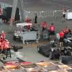 IndyCar crew teams work in the garage area at the race track in Sao Paulo, Brazil, Thursday, May 2, 2013.  Brazil will host the 4th race of the Indy Car season on May 5. (AP Photo/Andre Penner)