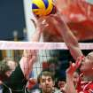 Russia's Alexander Savichev (right) puts a ball over the net during Russia's game against Germany during the fourth day of competition at the World Sitting Volleyball championships on the University of Central Oklahoma campus in Edmond, Okla., on Wednesday, July 14, 2010. Photo by John Clanton, The Oklahoman