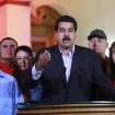 In this photo released by Miraflores Press Office, Venezuela's Vice-President Nicolas Maduro, center, accompanied by other members of the cabinet, delivers a speech at the presidential palace in Caracas, Venezuela, Tuesday, Dec. 11, 2012. Maduro said on Venezuelan television Chavez was recovering in Cuba after an operation targeting an aggressive cancer that has defied multiple treatments. The operation was