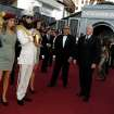 Sacha Baron Cohen, second from left, and guests arrive before the 84th Academy Awards on Sunday, Feb. 26, 2012, in the Hollywood section of Los Angeles. (AP Photo/Matt Sayles) ORG XMIT: OSC228