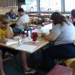 The Pen and Keyboard Writers meeting attendees work on an item to share. The group meets at Edmond's Golden Corral the third Saturday of each month from 10 AM to noon. New members are invited to the July 15 meeting.  Community Photo By:  Vivian Zabel  Submitted By:  Vivian,