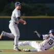 San Diego Padres second baseman Jedd Gyorko, left, throws to first base after forcing out Colorado Rockies' Charlie Blackmon at second base on the front end of a double play hit into by Drew Stubbs in the first inning of a baseball game in Denver on Saturday, May 17, 2014. (AP Photo/David Zalubowski)