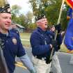 Members of American Legion post 88 in Norman march during the Veterans Day parade in Norman Sunday. PHOTO BY HUGH SCOTT FOR THE OKLAHOMAN ORG XMIT: KOD