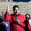 In this photo provided by Miraflores Presidential Press Office, Venezuela's Vice-President Nicolas Maduro, center, delivers a speech during a visit to