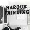In this early 1950s photo, Hussien Karoub looks at papers in his office at the Karoub Printing business in Highland Park, Mich. (AP Photo/Karoub Family)