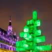 An abstract light installation replaces the traditional Christmas tree at the Grand Place in Brussels, Saturday Dec. 1, 2012. Traditionally, a 20m (65ft) pine tree from the forests of the Ardennes decorates the city's central square, the Grand Place. This year, it has been replaced with a 25m (82ft) construction. (AP Photo/Geert Vanden Wijngaert)