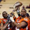 OSU's Marque Fountain (97), left, and Maurice Cummings (56) hold the Inisght Bowl trophy after the Insight Bowl college football game between Oklahoma State University (OSU) and the Indiana University Hoosiers (IU) at Sun Devil Stadium on Monday, Dec. 31, 2007, in Tempe, Ariz. OSU won, 49-33. BY NATE BILLINGS, THE OKLAHOMAN