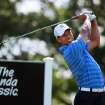 Tiger Woods tees off during a practice round for the Honda Classic golf tournament in Palm Beach Gardens, Fla., Tuesday, Feb. 28, 2012. (AP Photo/Palm Beach Post, Allen Eyestone) MAGS OUT TV OUT NO SALES