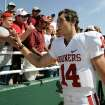OU / CELEBRATE / CELEBRATION: University of Oklahoma quarterback Sam Bradford (14) celebrates with fans following their win over Baylor in an NCAA college football game, Saturday, Oct. 4, 2008 in Waco, Texas. Oklahoma won 49-17.  (AP Photo/Tony Gutierrez) ORG XMIT: TXTG108