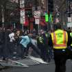 In this photo provided by The Daily Free Press and Kenshin Okubo, people react to an explosion at the 2013 Boston Marathon in Boston, Monday, April 15, 2013. Two explosions shattered the euphoria of the Boston Marathon finish line on Monday, sending authorities out on the course to carry off the injured while the stragglers were rerouted away from the smoking site of the blasts. (AP Photo/The Daily Free Press, Kenshin Okubo) MANDATORY CREDIT ORG XMIT: NYKS104