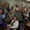 Democrtatic partisans cheer as ABC News declares that President Obama will be serving a second term, Tuesday, Nov. 6, 2012, at the Labor Temple in Wausau,Wis. (AP Photo/Wausau Daily Herald, Dan Young)