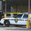 Authorities continue their investigation where three officers have been injured in a shooting at the Gloucester Township police station, and the suspect was shot and killed, Friday, Dec. 28, 2012, in Gloucester Township, N.J. (AP Photo/South Jersey Times, Lori M. Nichols) PHILLY METRO OUT NEWS