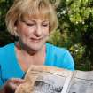 Sheila Rose found this wet and dirty book in her back Tuesday evening May 24, 2011, while she was cleaning light storm debris after violent thunderstorms passed over her Midwest City neighborhood, Among the tree branches and insulation that has landed on her lawn, Rose noticed an odd-shaped item beneath some trees. She picked it up and discovered it was a book about the early history of Chickasha. The covers and binding were missing as were the first 23 pages. Rose said the book has at least 135 pages and is filled with historical photos, facts and stories about the Grady County town.  Rose thinks the book may have been in a home or in the attic of   residences damaged by an afternoon tornado.  Photo by Jim Beckel, The Oklahoman
