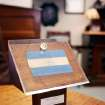 A plaque containing moon rocks and a small Nicaraguan flag are shown at the office of lawyer Richard Wright Friday, May 18, 2012, in Las Vegas. The plaque and moon rocks were originally presented as a gift to the people of Nicaragua by President Nixon. (AP Photo/Las Vegas Review-Journal, Ronda Churchill)