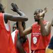Kevin Durant, right, of the Oklahoma City Thunder slaps hands with teammates during a charity basketball game hosted by Carmelo Anthony of the New York Knicks on Tuesday, Aug. 30, 2011, at Morgan State University in Baltimore. (AP Photo/Steve Ruark) ORG XMIT: MDSR104