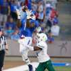 Tulsa's Keyarris Garrett (1) pulls down a long pass as Tulane's (4) Taurean Nixon watches during the first half  of an NCAA college football game on Thursday, Aug. 28, 2014, in Tulsa, Okla. (AP Photo/Tulsa World, Tom Gilbert) ONLINE OUT; KOTV OUT; KJRH OUT; KTUL OUT; KOKI OUT; KQCW OUT; KDOR OUT; TULSA OUT; TULSA ONLINE OUT