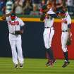 Atlanta Braves outfielders Justin Upton, left, Jason Heyward, center, and B.J. Upton,left, lift themselves up by the back of the shirt to celebrate a 6-3 victory over the Kansas City Royals Tuesday, April 16, 2013, in Atlanta for their 10th consecutive victory.    (AP Photo/Atlanta Journal-Constitution, Curtis Compton)