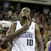 FILE - In this April 13, 2011 file photo, Sacramento Kings center Samuel Dalembert pounds his chest after scoring against the Los Angeles Lakers in the final moments of regulation play, in a NBA basketball game in Sacramento, Calif. Dalembert lost a cousin and several close friends among the estimated 300,000 killed when a magnitude-7.0 earthquake rumbled across his native Haiti on Jan. 12, 2010. Two years later, the NBA's only Haitian-born player prays for progress, while tempering his frustration that more hasn't been done to rebuild his crippled country.(AP Photo/Rich Pedroncelli)