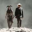 This publicity image released by Disney shows Johnny Depp as Tonto, left, and Armie Hammer as The Lone Ranger, in a scene from