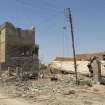This photo taken on Tuesday, July 1, 2014, shows destroyed homes after clashes between fighters of the al-Qaida-inspired Islamic State of Iraq and the Levant and Iraqi security forces in Tikrit, 80 miles (130 kilometers) north of Baghdad, Iraq. The Islamic State of Iraq and the Levant announced this week that it has unilaterally established a caliphate in the areas under its control. It declared the group's leader, Abu Bakr al-Baghdadi, the head of its new self-styled state governed by Shariah law and demanded that all Muslims pledge allegiance to him. (AP Photo)