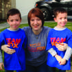 Nicole Jarvis poses with her twin 6-year-old sons, Zachary (left) and Ryan, in their Team Fox shirts. Photo provided.