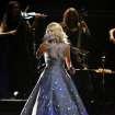 Carrie Underwood performs on stage at the 55th annual Grammy Awards on Sunday, Feb. 10, 2013, in Los Angeles. (Photo by John Shearer/Invision/AP) ORG XMIT: CAAR222