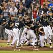 In this Wednesday, June 25, 2014 photo, Vanderbilt players celebrate after defeating Virginia 3-2 in Game 3 of the best-of-three NCAA baseball College World Series final in Omaha, Neb. (AP Photo/The World-Herald, Mark Davis) MAGS OUT; ALL NEBRASKA LOCAL BROADCAST TELEVISION OUT MAGS OUT