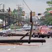 Downed power lines litter 24th Avenue Southwest at the Lindsey Street intersection after a tornado hit Friday afternoon April 13, 2013 in Norman, Okla. (AP Photo/The Norman Transcript, Kyle Phillips)