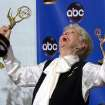 FILE - This Sept. 19, 2004 file photo shows actress Elaine Stritch celebrating with her trophy for outstanding individual performance in a variety or music program at the 56th Annual Primetime Emmy Awards in Los Angeles. Stritch died Thursday, July 17, 2014 at her home in Birmingham, Mich. She was 89. (AP Photo/Reed Saxon, File)