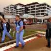 Hospital workers walk away from the Joplin Regional Medical Center in Joplin, Mo., Sunday, May 22, 2011. A large tornado moved through much of the city, damaging the hospital and hundreds of homes and businesses. (AP Photo/Mark Schiefelbein) ORG XMIT: MOMS108