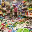 Nina Quidit cleans up the Dollar Plus and Party Supplies Store in American Canyon Calif. after an earthquake on Sunday Aug. 24, 2014. Quidit and her husband were woken up in the early morning hours by the store's alarm company and immediately drove in to begin clean up. The 6.0-magnitude quake caused six significant fires, including at four mobile homes, Napa Division Fire Chief Darren Drake said. (AP Photo/Alex Washburn)