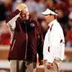 Head coaches Mike Sherman and Bob Stoops meet before the college football game between the University of Oklahoma Sooners (OU) and the Texas A&M at the Gaylord Familiy-Oklahoma Memorial Stadium on Saturday, Oct. 31, 2009, in Norman, Okla.