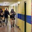 FILE - In this file photo of Jan. 28, 2013, members of the Washington County Sheriff's Office and the Hudson Falls Police Department use unleaded guns to take part in an emergency drill as they walk through a corridor inside the Hudson Falls Primary School in Hudson Falls, N.Y. School security has come under more scrutiny in the wake of the Sandy Hook Elementary School massacre in Newtown, Conn., that killed 26 people in December. (AP Photo/The Post-Star, Omar Ricardo Aquije, File)