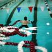 An Edmond High School student swimmer pulls a lane rope to the other end of the pool before practice at Oklahoma Christian University on Monday, Dec. 6, 2010. Photo by John Clanton, The Oklahoman