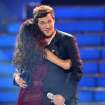 Runner-up Jessica Sanchez, left, congratulates winner Phillip Phillips onstage at the
