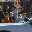 School children wait for their parents at the Sandy Hook firehouse following a mass shooting at the Sandy Hook Elementary School in Newtown, Conn. where authorities say a gunman opened fire, leaving 27 people dead, including 20 children, Friday, Dec. 14, 2012. (AP Photo/The Journal News, Frank Becerra Jr.) MANDATORY CREDIT, NYC OUT, NO SALES, TV OUT, NEWSDAY OUT; MAGS OUT ORG XMIT: NYWHI105