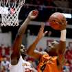 Oklahoma State's Brian Williams (4) shoots over Iowa State forward Anthony Booker during the first half of an NCAA college basketball game, Wednesday, March 6, 2013, in Ames, Iowa. (AP Photo/Justin Hayworth) ORG XMIT: IAJH104