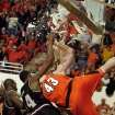 RENOVATION: OSU center Jason Keep (43) and Arkansas-Little Rock's Darius Eason break a backboard Tuesday, Dec. 19, 2000, at the first basketball game in Oklahoma State's remodeled Gallagher Iba Arena in Stillwater, Okla.  (AP Photo/Stillwater News Press, Brody Schmidt)
