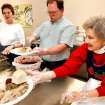 Judy Lewis, Nelson Dent, and Dorothy Claxton dish up Christmas dinner at St. Michael Episcopal Church's event on Friday, Dec. 25, 2009, in Norman, Okla.   Photo by Steve Sisney, The Oklahoman