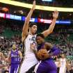 Utah Jazz's center Enes Kanter (0) defends as Sacramento Kings' guard Ben McLemore (R) drives the basket in the first half of an NBA basketball game on Saturday, Dec. 7, 2013, in Salt Lake City. (AP Photo/Kim Raff)