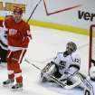 Los Angeles Kings goalie Jonathan Quick (32) looks up as Detroit Red Wings left wing Justin Abdelkader (8) celebrates the goal by teammate center Pavel Datsyuk during the second period of an NHL hockey game in Detroit, Wednesday, April 24, 2013. (AP Photo/Carlos Osorio)