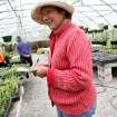 Susan Graf talks with customers at her certified organic Crestview Farms in Edmond on May 3, 2009. Photo by John Clanton
